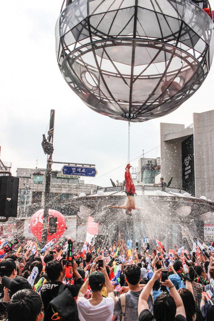 Sinchon water gun festival performer and people throwing water